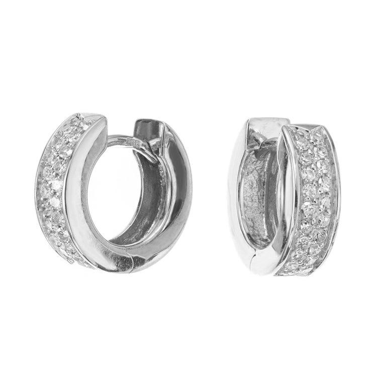 Diamond huggie hoop earrings. 38 single cut round diamonds set in 14k white gold settings. 4mm wide  38 single cut diamonds, H-I VS approx. .30cts 14k white gold  Stamped: 585 4.1 grams Top to bottom: 12.6mm or .5 Inch Width: 4.0mm or 3/16