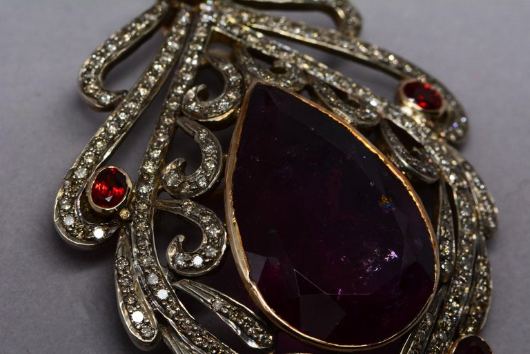 30 Carat Pear Shaped Tourmaline with Diamonds, Garnets, 15kt Gold/Silver Brooch In Good Condition For Sale In Aurora, Ontario