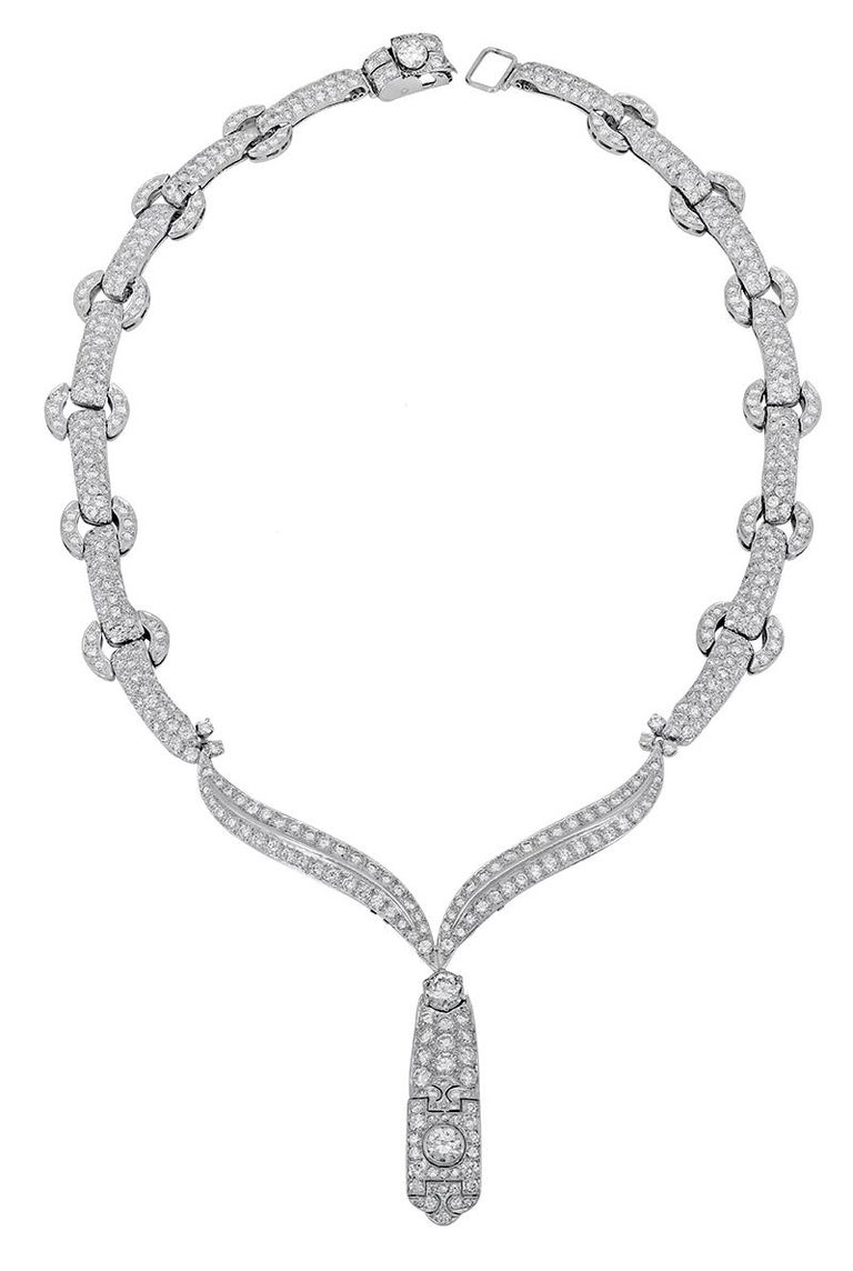 A simple statement piece showcasing diamond encrusted links made in 18k white gold. An intricately designed pendant elegantly drops from the necklace and is set with more brilliant diamonds. The drop pendant is detachable and can be removed.  Length