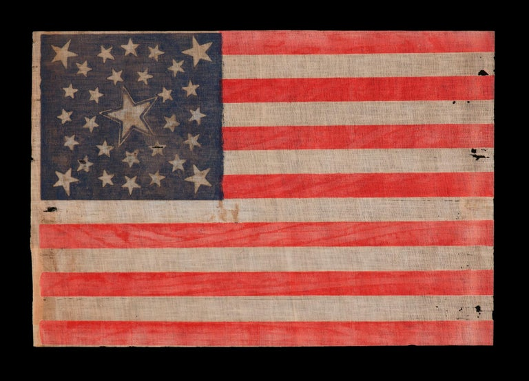 30 STAR FLAG OF THE PRE-CIVIL WAR ERA, A RARE AND BEAUTIFUL ANTIQUE EXAMPLE WITH A DOUBLE-WREATH CONFIGURATION THAT FEATURES A LARGE, HALOED CENTER STAR, WISCONSIN STATEHOOD, 1848-1850:  30 star American parade flag, block-printed on coarse cotton,