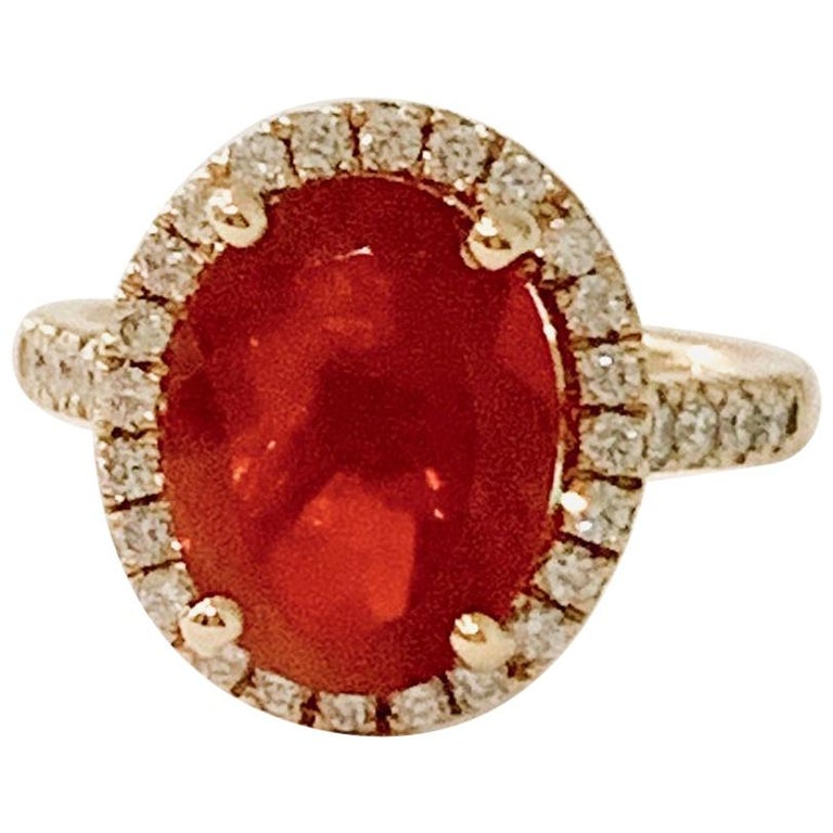 3.00 Carat AAA Oval Fire Opal Set in Diamond Halo Ring in 18 Carat Yellow Gold For Sale