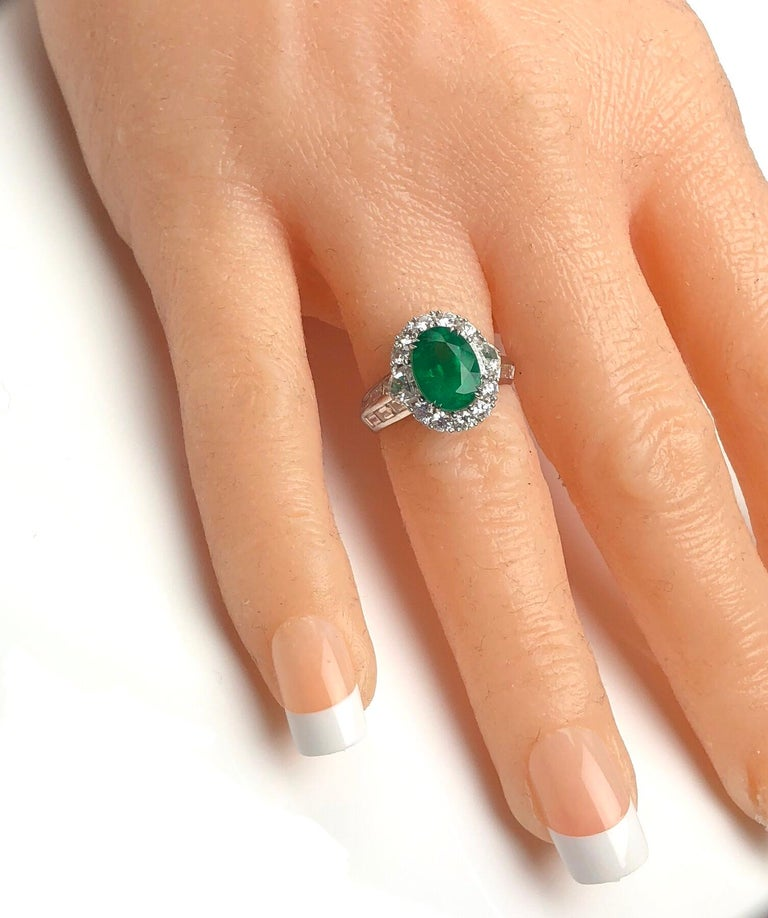 Women's 3.00 Carat Oval Cut Colombian Emerald and 2.50 Carat Diamond Ring For Sale