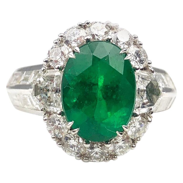 3.00 Carat Oval Cut Colombian Emerald and 2.50 Carat Diamond Ring For Sale