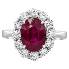 3.00 Carat Oval Cut Ruby and Diamond Halo Engagement Ring