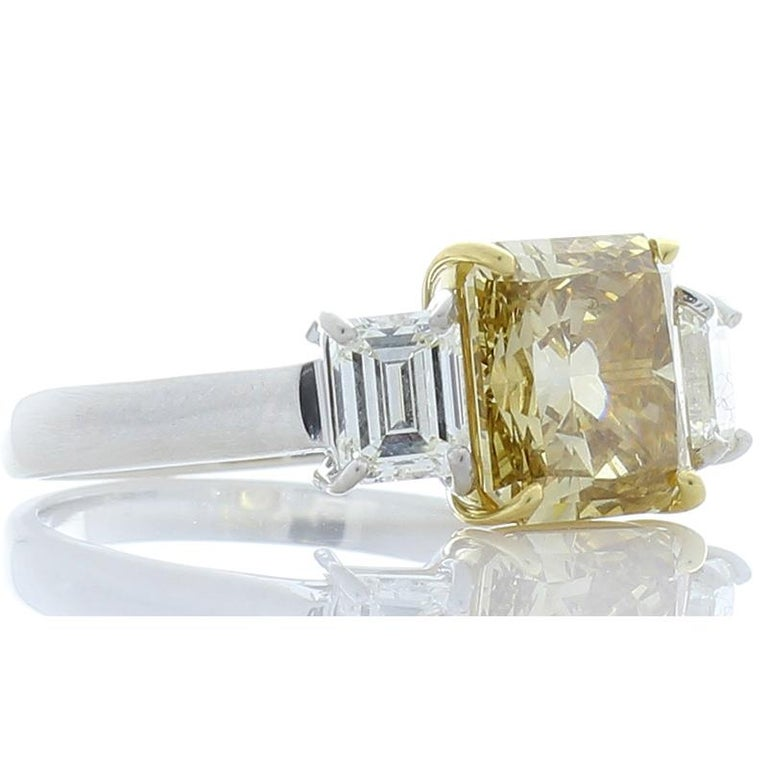 Contemporary 3.00 Carat Radiant Cut Fancy Yellow Diamond Cocktail Ring in Platinum For Sale