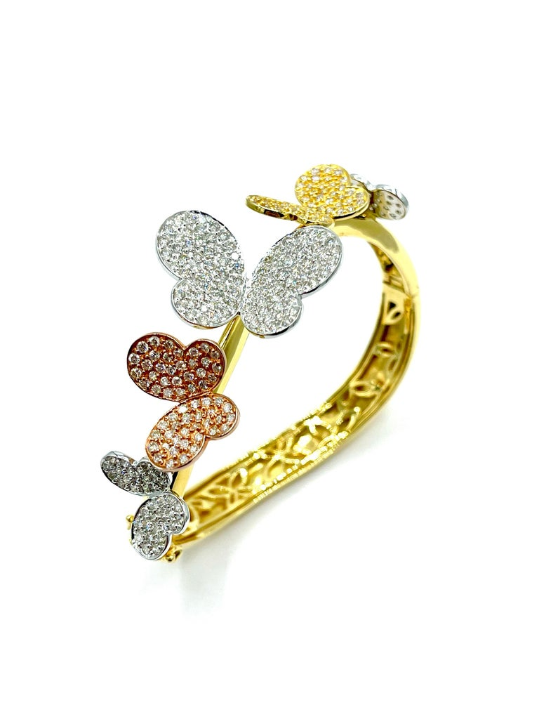 Such a whimsical bracelet to accessorize with!  The 3.00 carats in round brilliant Diamonds are pave set into five separate butterflies on the top half of the bracelet.  The butterflies are made in 18K white gold, rose gold, and yellow gold, with