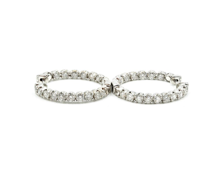 Designer: custom design Material: 14k white gold Diamonds: 34 round brilliant cut diamonds = 3.00 carat total weight Color: H-J Clarity: SI2-I1 Dimensions: each hoop is 1-inch diameter Weight: 8.73 grams