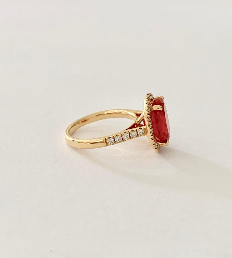 Oval Cut 3.00 Carat AAA Oval Fire Opal Set in Diamond Halo Ring in 18 Carat Yellow Gold For Sale