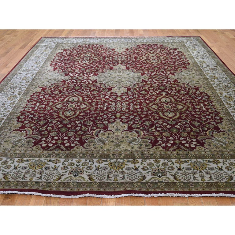 This is a truly genuine one-of-a-kind 300 Kpsi Kashan Revival New Zealand wool hand knotted Oriental rug. It has been knotted for months and months in the centuries-old Persian weaving craftsmanship techniques by expert artisans. Measures: 8'9