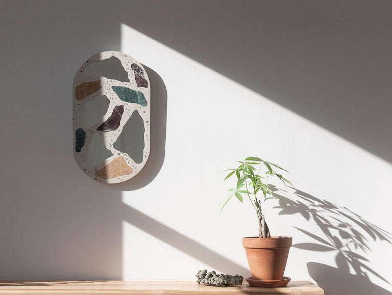 Named for the sandpaper grit required to polish its surface to a smooth plane, the #3000 mirror emulates the honed terrazzo floors of Milanese lobbies and Venetian palazzos. Cast in concrete, its polychrome marble, mirror, and aggregate material