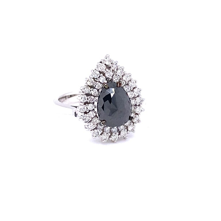 Stunning Pear Cut Black and White Diamond  Bridal Ring Description as follows:  Pear Cut Dia = 2.32 carats 43 Round Cut Diamonds = 0.69 carats (Clarity: SI, Color: F) 14 Karat White Gold/5.3 grams  Ring Size: 7 (complimentary ring sizing available