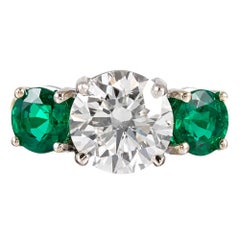 3.01 Carat Diamond and Emerald Three-Stone Ring