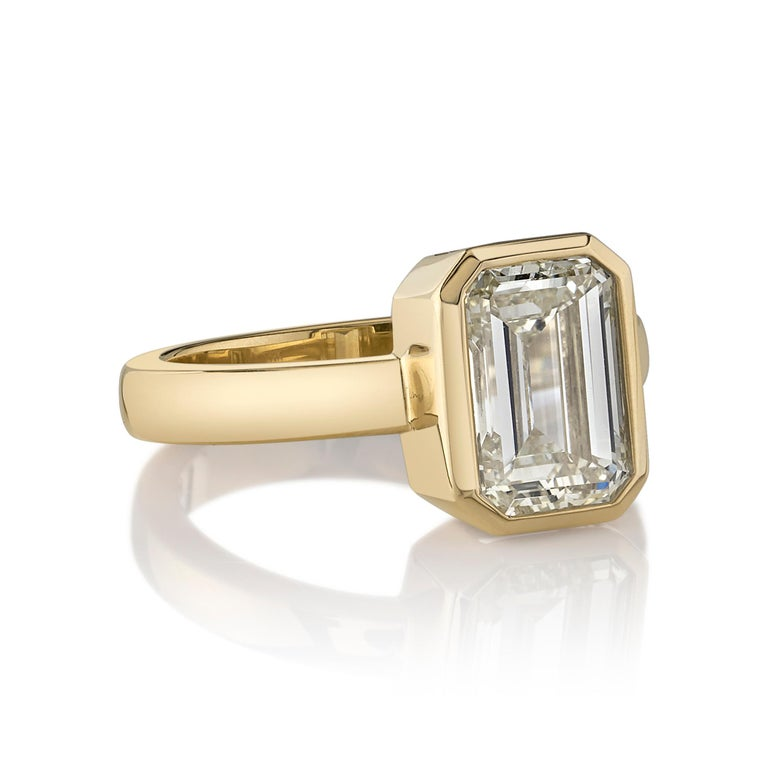3.01ctw U-V/VVS2 GIA certified Emerald cut diamond set in a handcrafted 18K yellow gold mounting.  Ring is currently a size 6 and can be sized to fit.