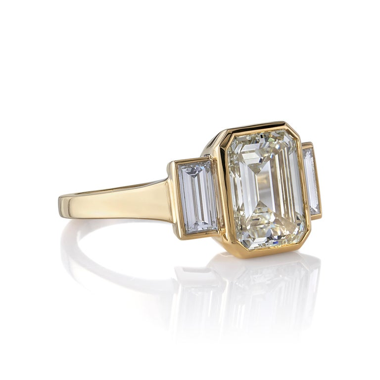 3.01ctw U-V/VVS2 GIA certified Emerald cut diamond with 0.66ctw Baguette cut accent diamonds set in a handcrafted 18K yellow gold mounting.  Ring is currently a size 6 and can be sized to fit.