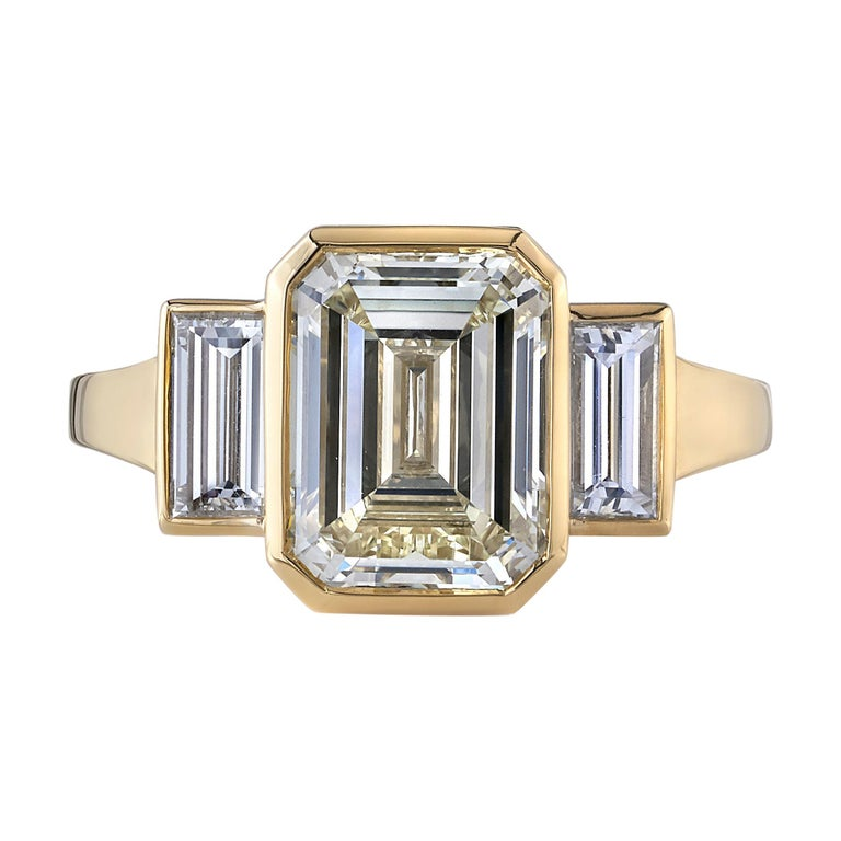 3.01 Carat Emerald Cut Diamond Set in a Handcrafted Yellow Gold Engagement Ring For Sale