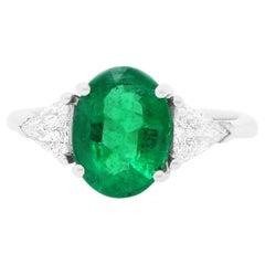 Oval Emerald and Trillion Diamond Three Stone Engagement Ring