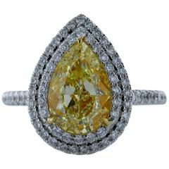 3.02 Carat Fancy Yellow Pear Shape SI1 Diamond Ring and Pendant 18 Karat