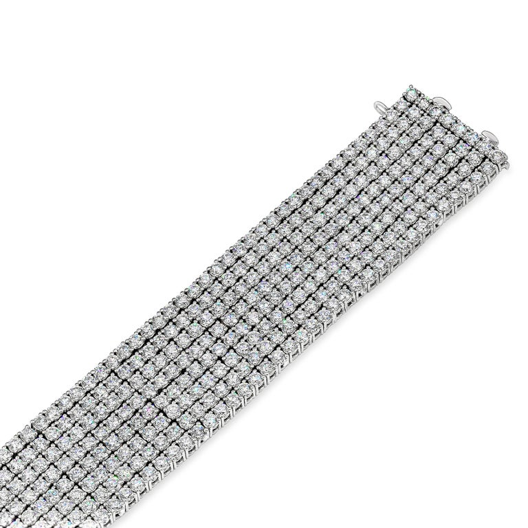 A classic and important tennis necklace featuring eight rows of round brilliant diamonds, set in a polished 18k white gold. Diamonds weigh 30.20 carats total and are approximately G color, VS-SI clarity. Double lock mechanism for maximum security
