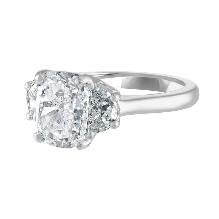 3.03 Carat Cushion, GIA Certified, Set in Three-Stone Platinum Ring