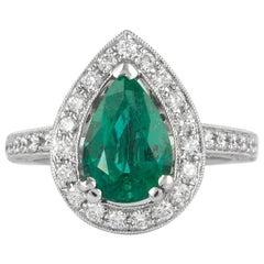 3.03 Carat Emerald with Diamond Halo Ring 18 Karat White Gold