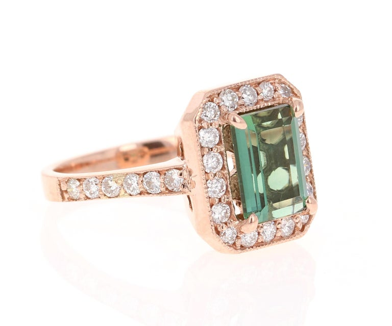 A beauty that is different and one of a kind. Can be a beautiful Engagement, Wedding, or Anniversary Ring.   This ring has a magnificently beautiful Emerald Cut Green Tourmaline that weighs 2.32 Carats and has 36 Round Cut Diamonds weighing 0.71