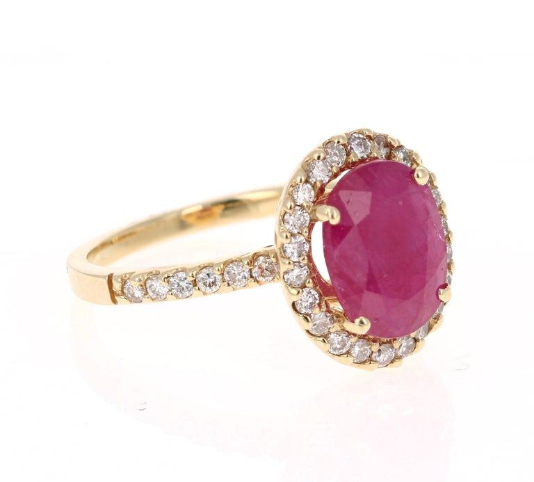 Simply beautiful Ruby Diamond Ring with a Oval Cut 2.59 Carat Ruby which is surrounded by 34 Round Cut Diamonds that weigh 0.45 carats. The total carat weight of the ring is 3.04 carats. The clarity and color of the diamonds are VS-H.  The ring is