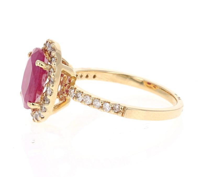 Modern 3.04 Carat Oval Cut Ruby Diamond 14 Karat Yellow Gold Engagement Ring For Sale