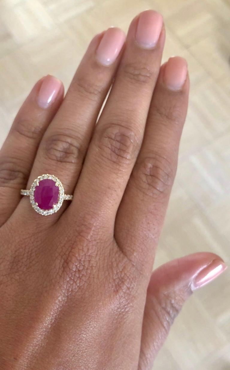 Women's 3.04 Carat Oval Cut Ruby Diamond 14 Karat Yellow Gold Engagement Ring For Sale