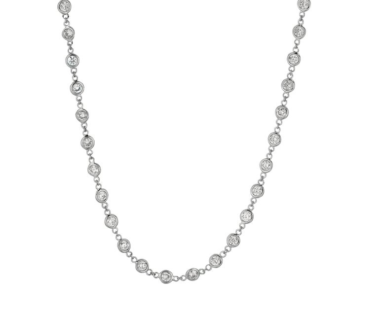 3.05 Carat Diamond by the Yard Necklace G SI 14K White Gold 18 inches 62 stones 5 pointers      100% Natural Diamonds, Not Enhanced in any way Round Cut Diamond by the Yard Necklace       3.05CT     Color  G-H      Clarity SI       14K White Gold,