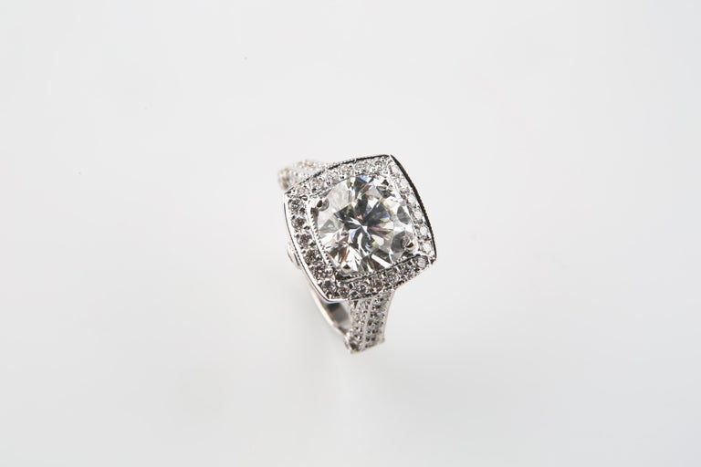 Beautiful 14k White Gold Diamond Halo Engagement Ring Shank Features Pave Diamond throughout the Setting and Basket With 6 Bezel set Diamonds (Setting contains 1.00ct TDW) Features a Large Brilliant Round Cut 3.05ct Diamond GIA Cert
