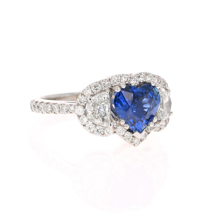 Beautiful Sapphire Diamond ring with an intricate setting!   This ring has a gorgeous Heart Cut Blue Sapphire that weighs 1.93 Carats and is GIA Certified. The Sapphire is a natural Blue Heart Cut with Heating. The GIA Certificate Number is: