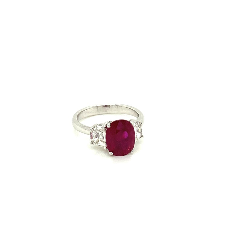 3.06 Carat GRS Certified Pigeon's Blood Red Burmese Ruby and White Diamond Ring:  A rare ring, it features a stunning GRS certified oval natural Burmese pigeon's blood red ruby weighing 3.06 carat, with white half-moon cut diamonds on both sides of