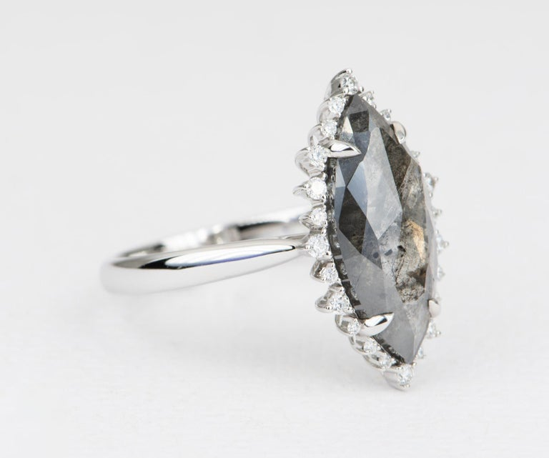 ♥  This beautiful salt and pepper marquise diamond sits in the center and in set with four prongs.  ♥  The center is flanked by white sparkly diamonds, then set in a long shield/kite shape. ♥  The setting is slightly raised, so it will stack flush