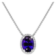 30.62 Carat Oval Tanzanite Halo Pendant Necklace 18 Karat White Gold Fancy Chain