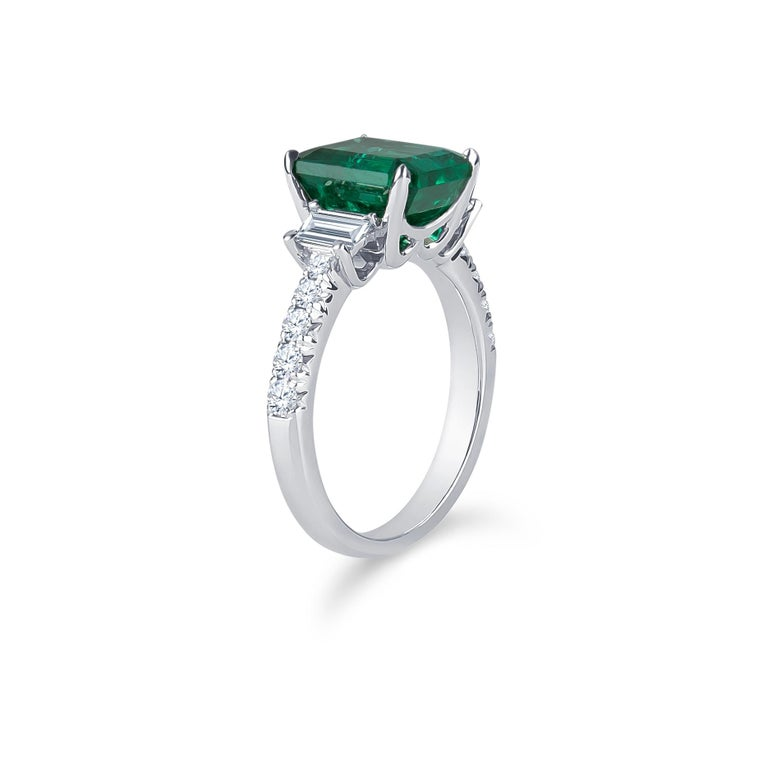 Emerald Cut 3.06Carat Emerald Ring (AGL) with 0.96 CTW of Trapezoid Step Cut Diamonds in 18K For Sale