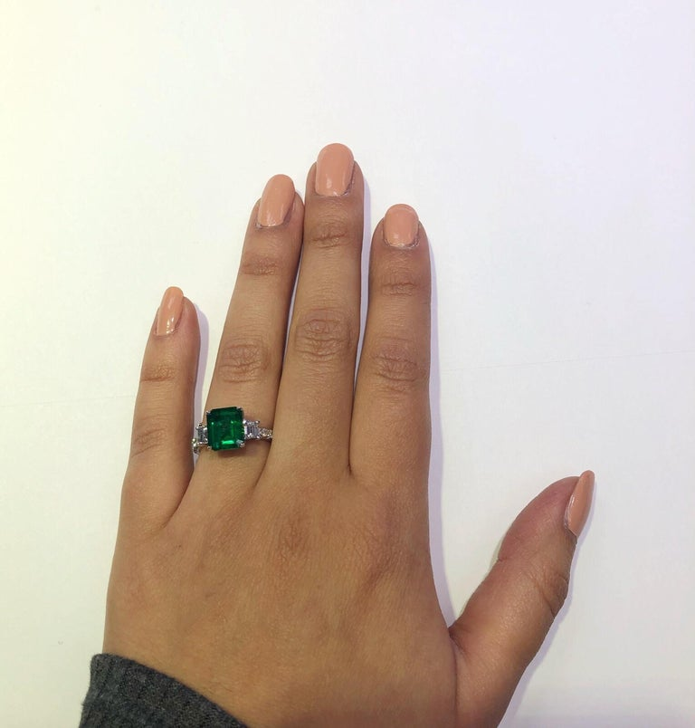3.06Carat Emerald Ring (AGL) with 0.96 CTW of Trapezoid Step Cut Diamonds in 18K In Excellent Condition For Sale In Houston, TX