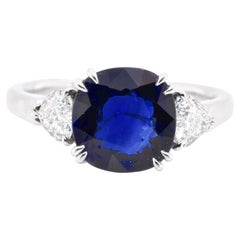 3.08 Carat Natural Sapphire and Diamond Three-Stone Ring Set in Platinum
