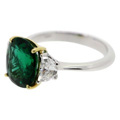 3.08 Carat Oval Emerald and 2 Half-Moon Natural White Diamonds Cocktail Ring