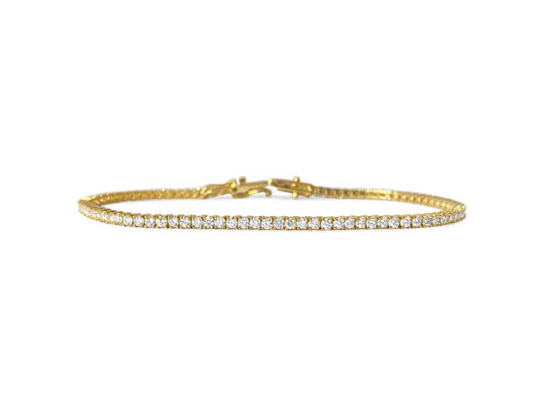 Metal: 10k yellow gold.  Diamonds: 3.08cwt.  VVS clarity. H color. 100% natural earth mined diamonds. Round brilliant cut set in prongs. Gorgeous finish and shine. Top of the line unisex diamond tennis bracelet.