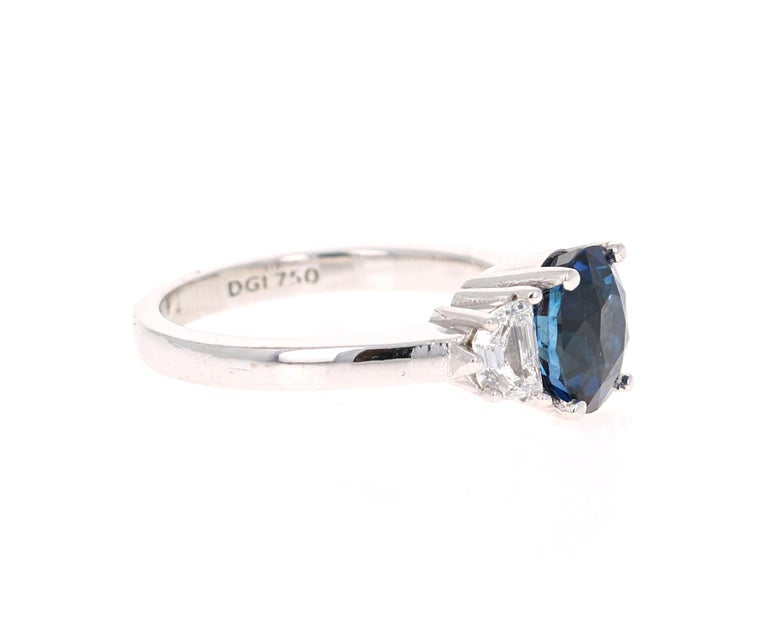 Beautiful Sapphire Diamond Three-Stone Engagement Ring  This ring has a Blue Sapphire that weighs 2.47 Carats and is GIA Certified. The Sapphire is a natural Blue Oval Cut with Heat. The GIA Certificate Number is: 2181190068 and can be verified on
