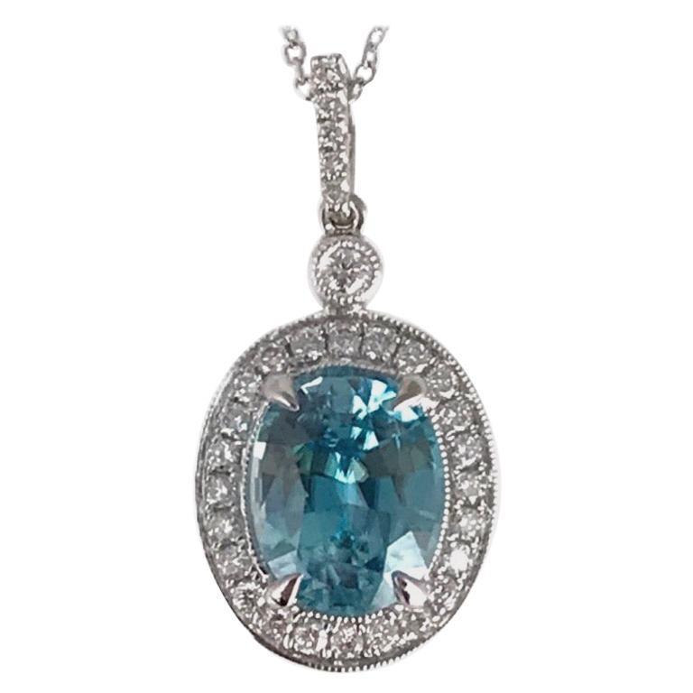 DiamondTown 3.09 Carat Oval Cut Blue Zircon and Diamond Pendant  For Sale