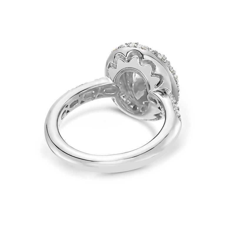 Oval Cut 3.09 Carat Yellow Diamond Oval Halo Setting Engagement Ring For Sale
