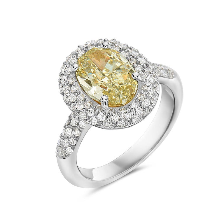 3.09 Carat Yellow Diamond Oval Halo Setting Engagement Ring In New Condition For Sale In New York, NY