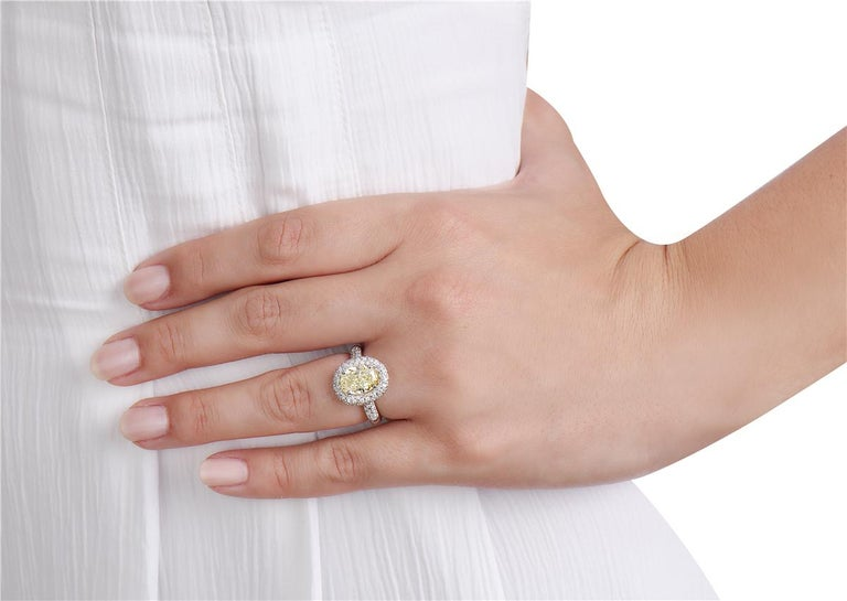 Women's 3.09 Carat Yellow Diamond Oval Halo Setting Engagement Ring For Sale