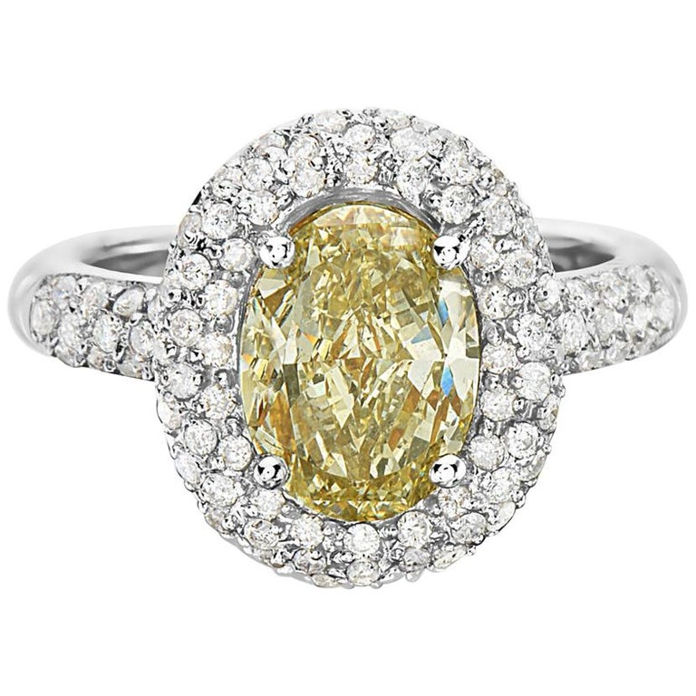 3.09 Carat Yellow Diamond Oval Halo Setting Engagement Ring For Sale