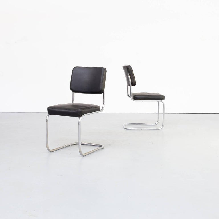 Set of 2 Mart Stam side chairs with black skai finish. Classic chrome cantilever frames.