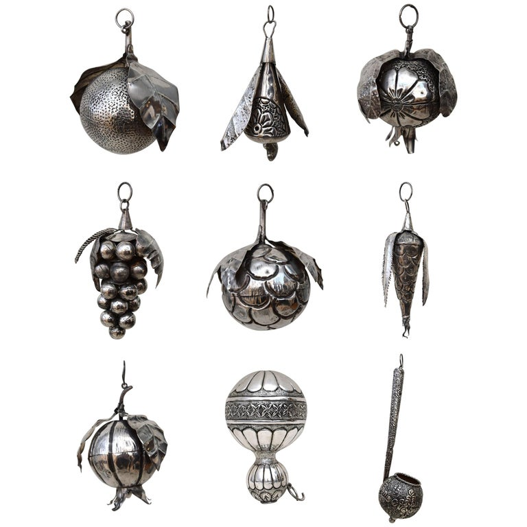 These 31 Brazilian amulets, or balangada, were hammered from sheets of silver in the 19th century to form pomegranates, sugar apples, guava, and other exotic fruits. Symbols of fertility, they were the bling of their day, adorning the wrists and
