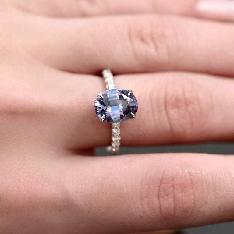 How beautiful it sounds - noble spinel.  All spinels are divided in two groups - ordinary and noble spinel.  Noble spinels are stones with transparent open colors - red, blue, pink, violet and gray. Spinel in this ring is noble violet-gray