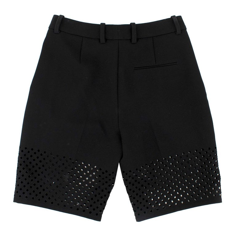 Phillip Lim Black Lasercut Bermuda Shorts  - Black bermuda shorts  - Laser cut outs to the bottom  - Zip, button and hooks fastening to the middle front - Lined - Belt hoops  Please note, these items are pre-owned and may show some signs of storage,