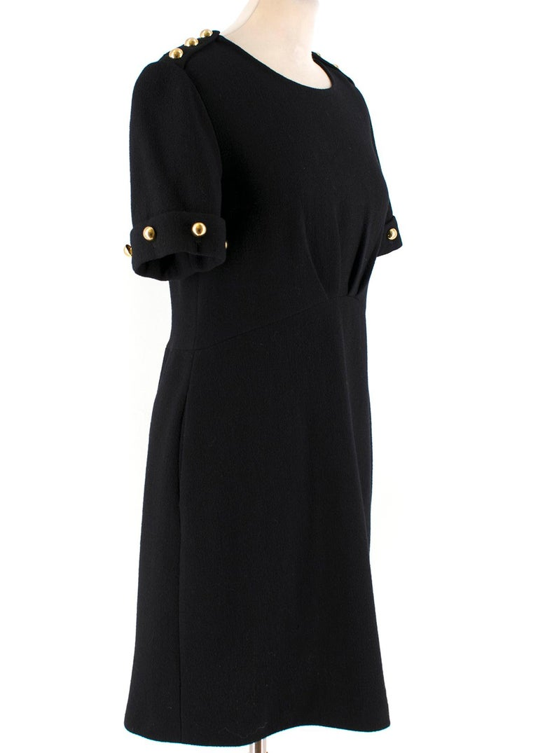3.1 Phillip Lim Black Stud Dress  -Black dress with gold toned studs -Pleats around the waistline -Back zip closure -Short sleeve knee length dress  Please note, these items are pre-owned and may show signs of being stored even when unworn and